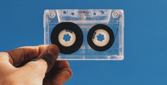 Hand holding cassette tape