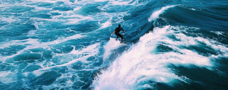 man surfing on ocean